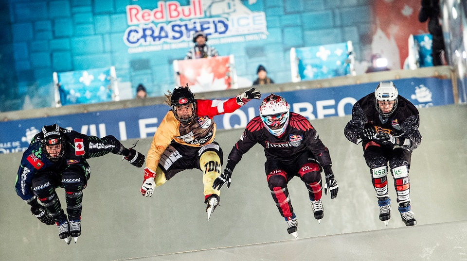 Daniel Bergeson of the United States, Derek Wedge of Switzerland, Marcel Beauchesne of Canada and Mark Taru of Estonia compete during the first stage of the Ice Cross Downhill World Championship at the Red Bull Crashed Ice in Quebec City, Canada on November 28, 2015. // Joerg Mitter / Red Bull Content Pool // P-20151129-00006 // Usage for editorial use only // Please go to www.redbullcontentpool.com for further information. //