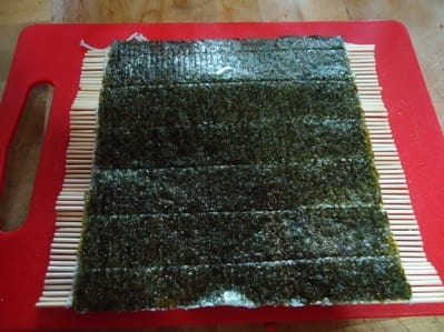 A sushi mat makes this easy, but a tea towel also works.