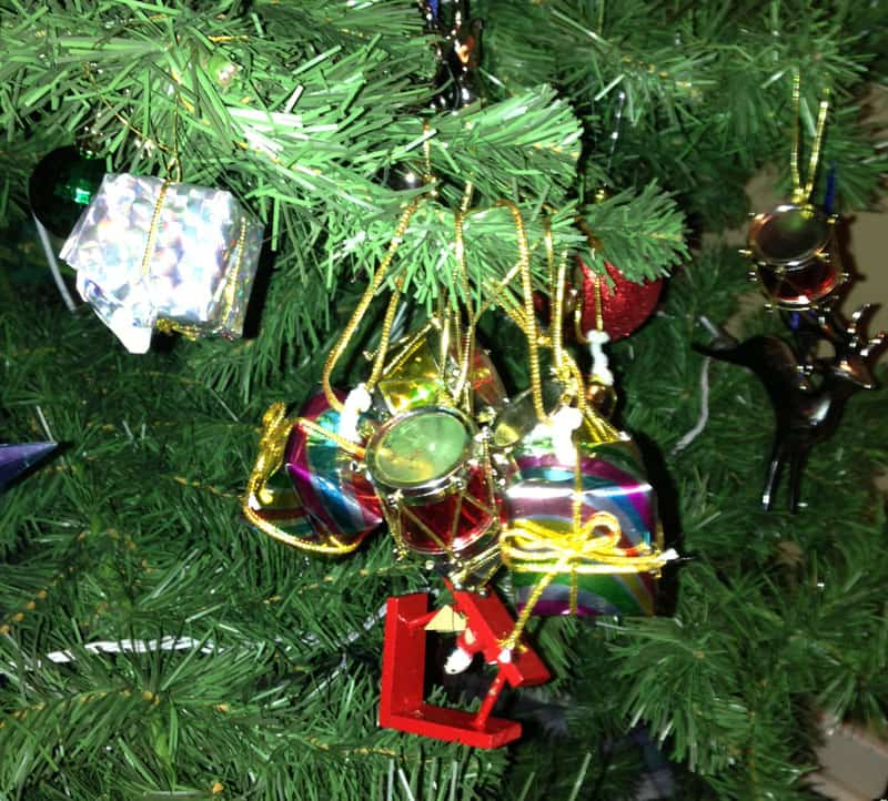 Christmas tree branch full of ornaments