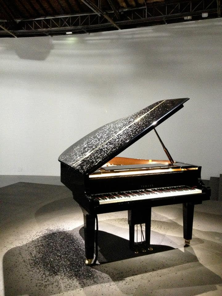 Piano playing on its own with ash raining from the sky