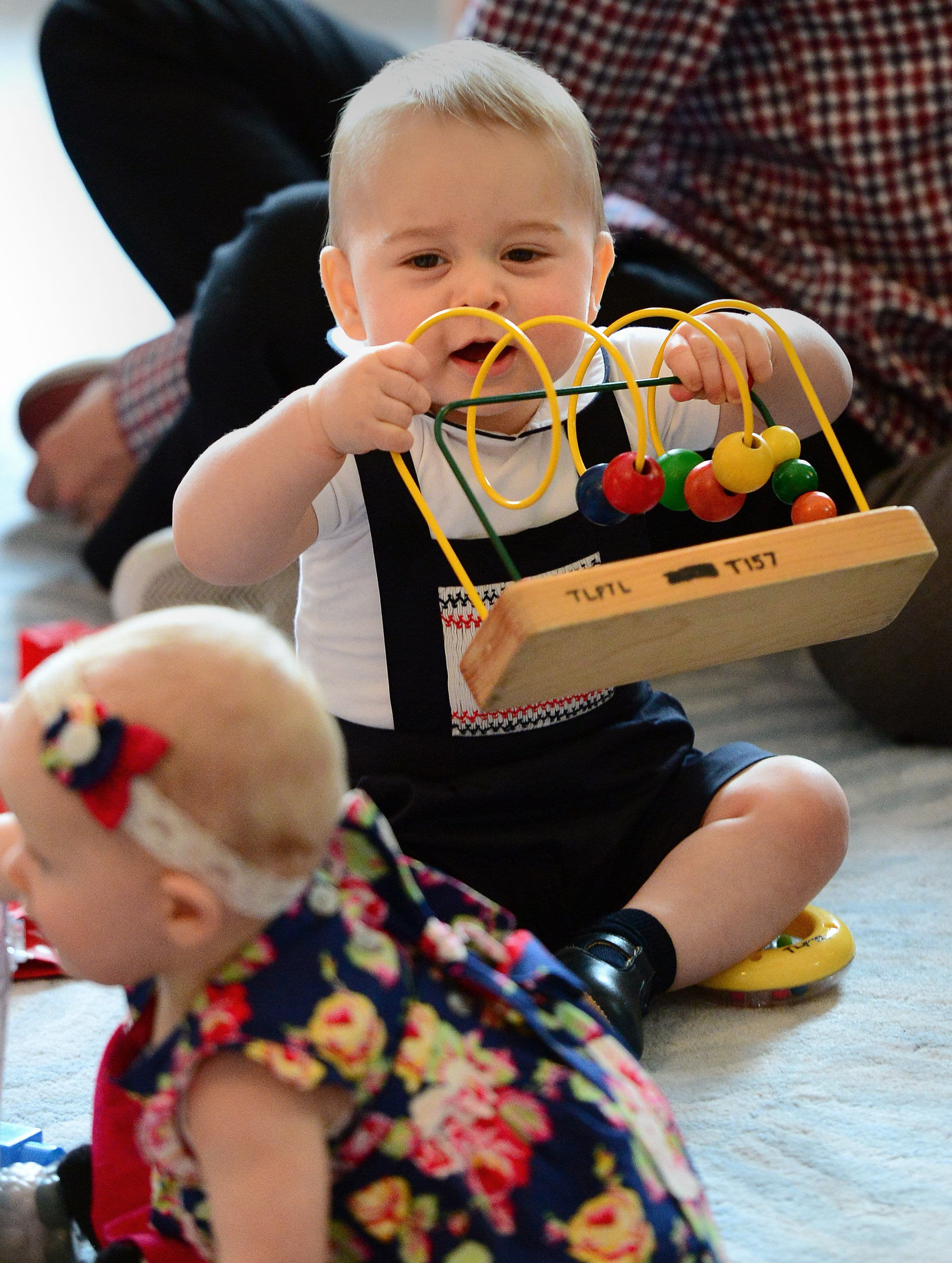 Prince George playing with a toy