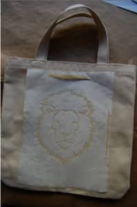 Iron the stencil to the tote bag (shiny side down!)