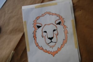 Colour in the areas you want to cut away, then tape the template to a sheet of freezer paper.
