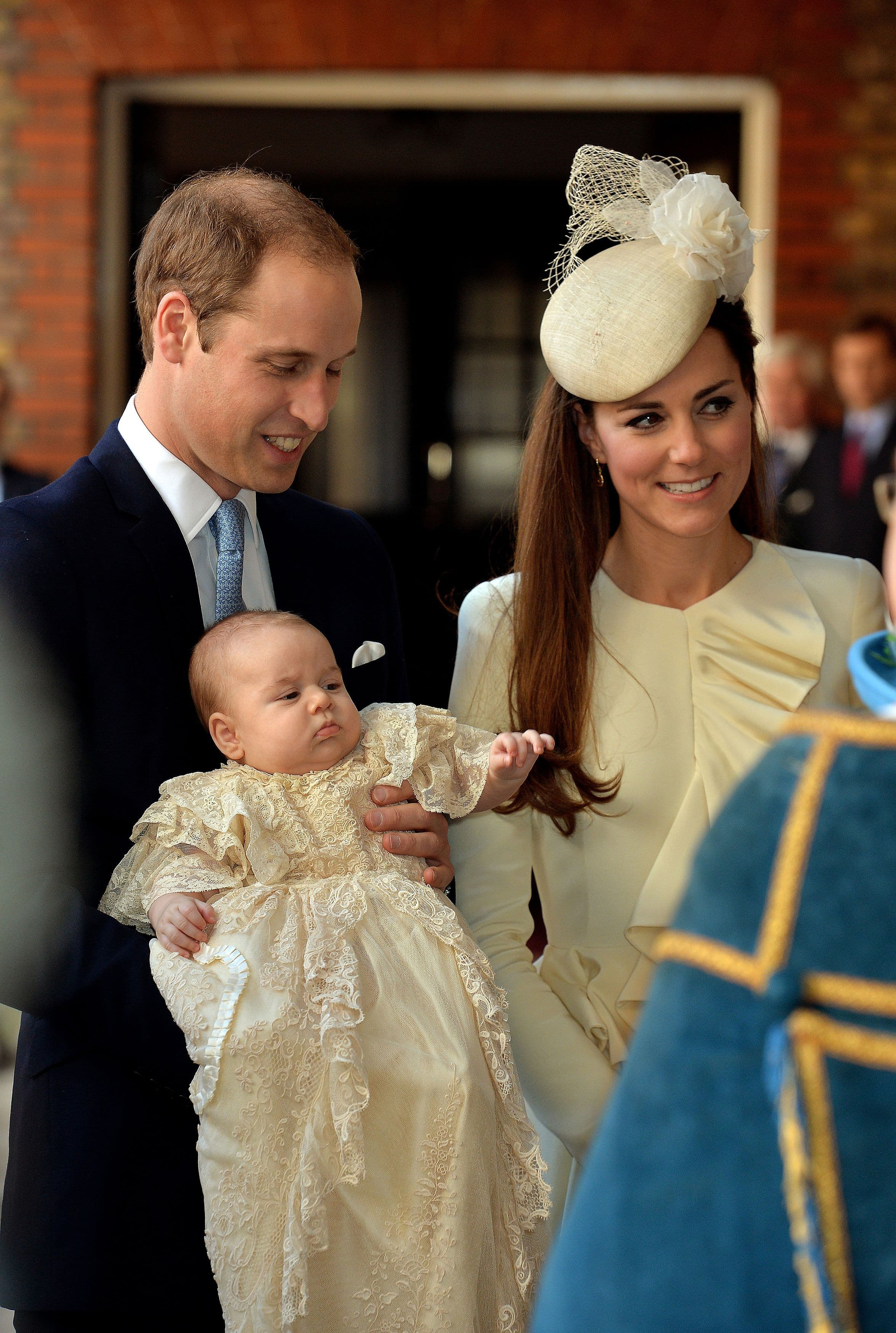 Kate Middleton and Prince William with Prince George at his christening
