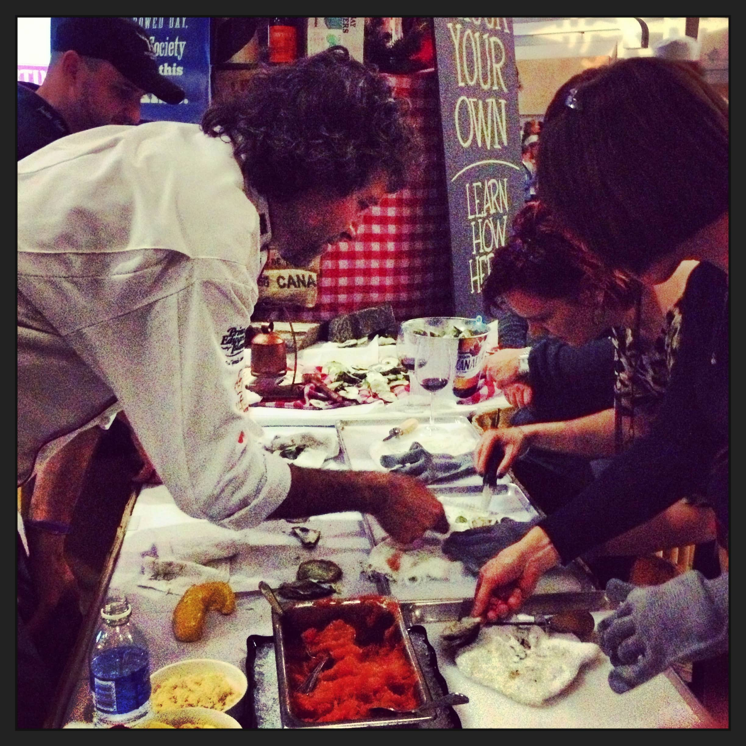 Chef Michael Smith shucking oysters