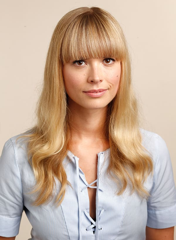 An image of Mosha Lundstrom and her blunt blond bangs.