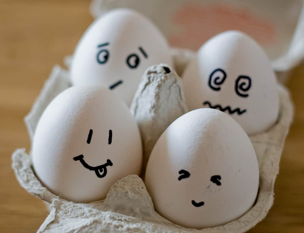 Carton of eggs with funny faces