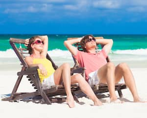 Happy Romantic Couple Enjoying the Sun at the Beach