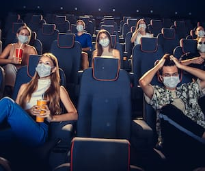 Cinema, movie theatre during quarantine. Coronavirus pandemic safety rules, social distance during movie watching
