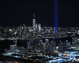 US-TRIBUTE-IN-LIGHT-PROJECTS-INTO-NYC-SKY-ON-20TH-ANNIVERSARY-OF