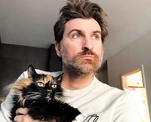 Jean-Thomas Jobin et son chat Papa Prune.