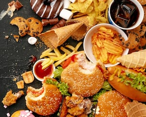 Fast food dish and healthy nutrition on black stone background