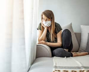Woman in isolation at home for virus outbreak. Young woman in isolation at home for coronavirus. Woman in Isolation Quarantine Coronavirus. Sad lonely girl isolated stay at home