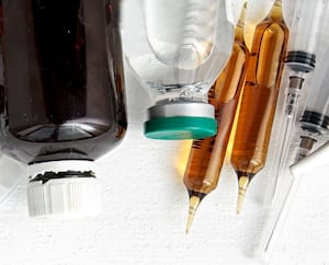 A lot of different drugs, pills and other medicine on the wooden white table