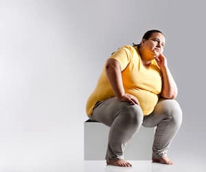 Obese woman thinking