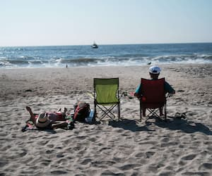 US-UNSEASONABLY-HOT-WEATHER-IN-OCTOBER-CONTINUES-TO-DRAW-SWIMMER