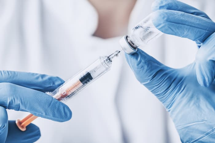 injecting injection vaccine vaccination medicine flu woman doctor