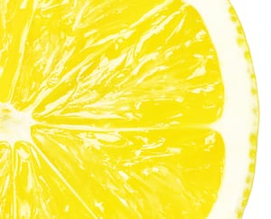 Juicy yellow slice of lemon, clipping path, white background, isolated