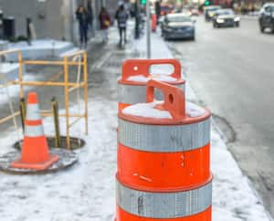 The orange traffic cone on the sidewalk in Montreal downtown, Canada