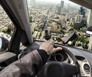 photo manipulation driving a flying car to bypass traffic