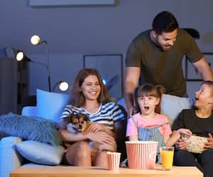 Family watching scary movie in evening