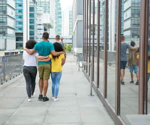 Team of male and female friends enjoying outdoor walk