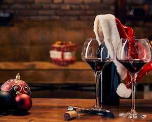 Glasses of red wine on table at home at Christmas