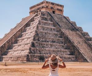 A woman enjoying travel tourism at Chichen Itza, Mayan Riviera, Mexico