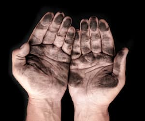 dirty male hands on a black background