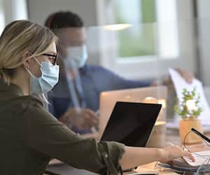 Multiracial staff at work in cowork office - Young people wearing surgical mask for coronavirus