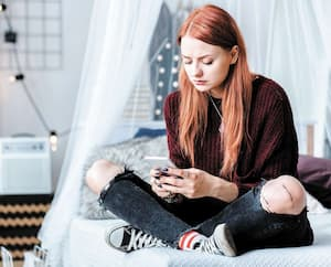 Problematic teenager using smartphone