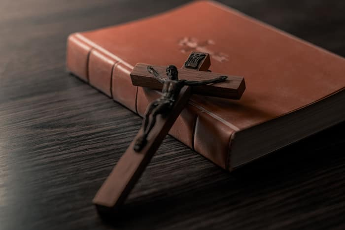 Old Holy Bible and Crucifix. Concept for religious events