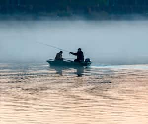 Fishermen on a river at the early morning