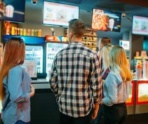 Friends choosing food in cinema bar