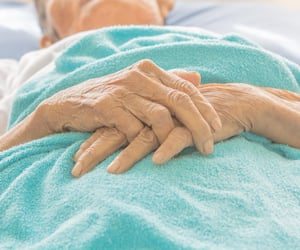 old Hand women on bed patient