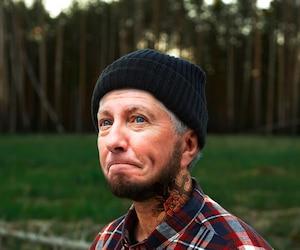 Portrait of bearded Lumberjack with Axe