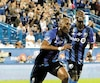 Rod Fanni célèbre son but face aux Red Bulls de New York avec Micheal Azira et Daniel Lovitz lors du dernier match de l'Impact avant la pause internationale.
