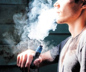 vape man. the modern young person produces clouds of vapor