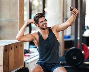Young fitness man makes selfie
