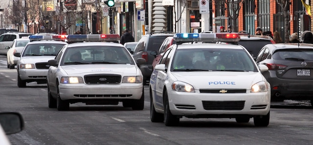 18e manifestation contre la brutalité policière (COBP) à Montréal en ce samedi 15 mars 2014. PHILIPPE-OLIVIER CONTANT/AGENCE QMI