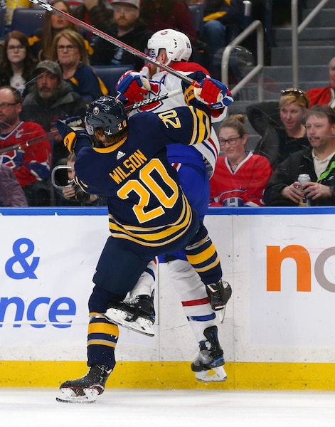 BUFFALO, NY - MARCH 23: Scott Wilson #20 of the Buffalo Sabres checks Jeff Petry #26 of the Montreal Canadiens during the second period at KeyBank Center on March 23, 2018 in Buffalo, New York.   Kevin Hoffman/Getty Images/AFP == FOR NEWSPAPERS, INTERNET, TELCOS & TELEVISION USE ONLY ==