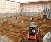 La Place du marché Wallberg commence à prendre forme, alors qu'on procède ces jours-ci à des travaux de remblayage dans ce qui deviendra le stationnement sous-terrain.