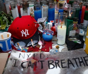 File photo of candles at the memorial of Eric Garner in Staten Island