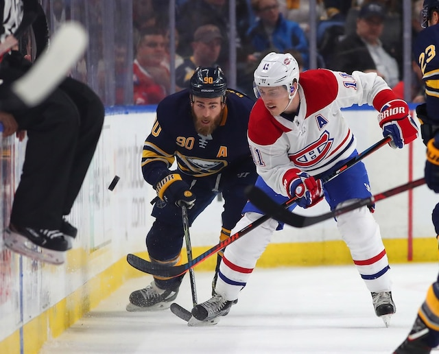 BUFFALO, NY - MARCH 23: Ryan O'Reilly #90 of the Buffalo Sabres and Brendan Gallagher #11 of the Montreal Canadiens go after a puck on the boards during the first period at KeyBank Center on March 23, 2018 in Buffalo, New York.   Kevin Hoffman/Getty Images/AFP == FOR NEWSPAPERS, INTERNET, TELCOS & TELEVISION USE ONLY ==