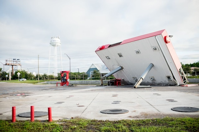 The overhang of a gas station is toppled over in the aftermath of Hurricane Michael on October 11, 2018 in  Inlet Beach, Florida. - Residents of the Florida Panhandle woke to scenes of devastation Thursday after Michael tore a path through the coastal region as a powerful hurricane that killed at least two people. (Photo by Emily KASK / AFP)