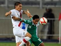 Peru's Paolo Guerrero fights for the ball with Nigeria's Soriola Gege during their international friendly soccer match at the National Stadium in Lima