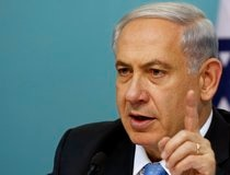 Israel's Prime Minister Benjamin Netanyahu gestures during a news conference at his office in Jerusalem