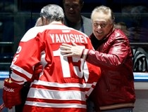 Canadian former professional ice hockey players Esposito greets former rival Russian hockey player Yakushev in Moscow