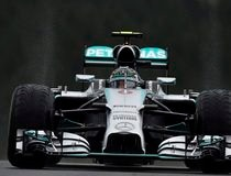 Mercedes Formula One driver Nico Rosberg of Germany drives in the pit lane during the qualifying session at the Belgian F1 Grand Prix in Spa-Francorchamps