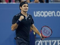 Roger Federer of Switzerland celebrates defeating Sam Groth of Australia in their men's singles match at the 2014 U.S. Open tennis tournament in New York